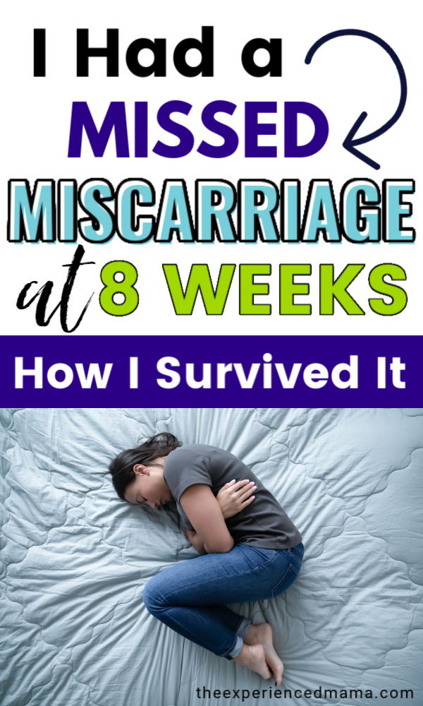 woman having miscarriage at 8 weeks, curled up on bed holding stomach