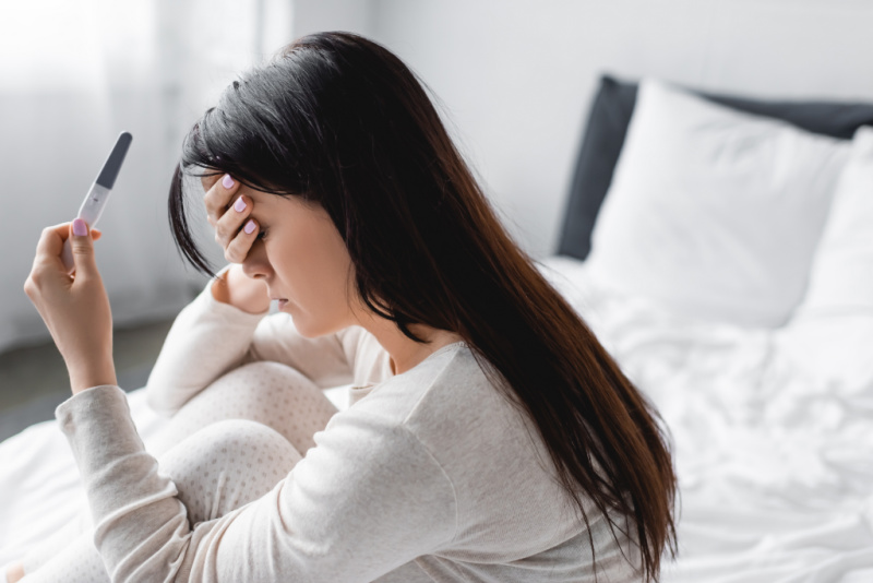 woman struggling with infertility devastated by negative pregnancy test