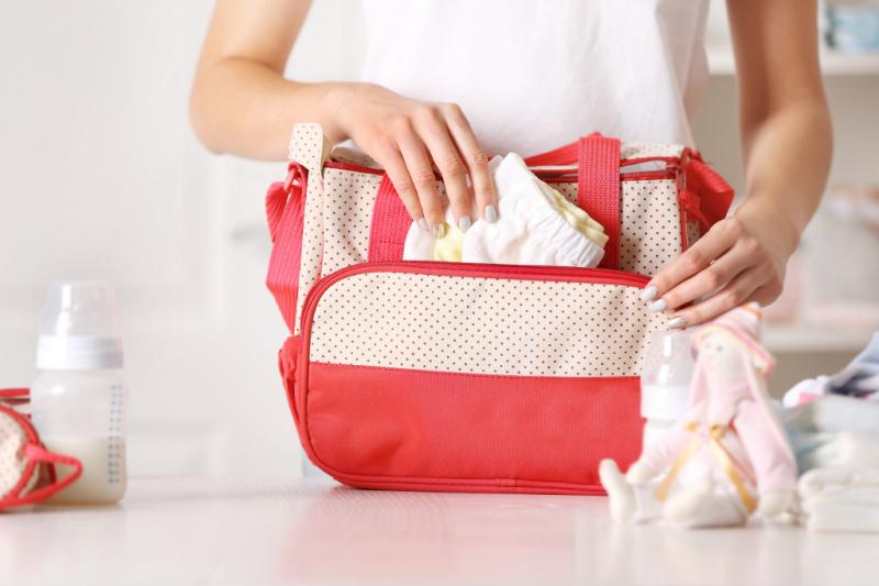 mom restocking a minimalist diaper bag